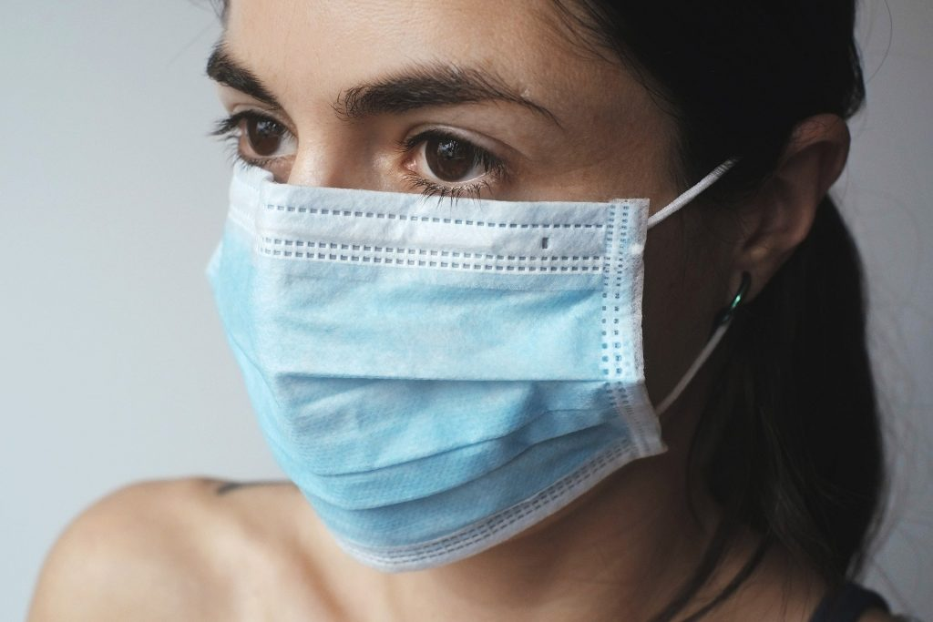 Picture of a woman wearing a mask.